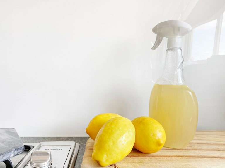 Lemons and a spray cleaner on a countertop